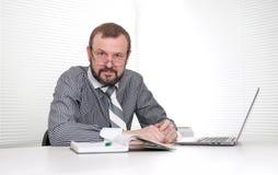 Senior businessman in the office Stock Photos