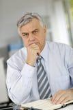 Senior businessman at office being serious Stock Photos