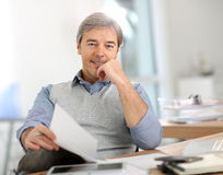 Senior businessman at office Stock Photo