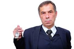 Senior businessman with a pocket watch. Studio shot of a senior businessman with a pocket watch. Isolated on white Royalty Free Stock Photo