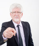 Senior businessman pointing. A finger in a we want you gesture Royalty Free Stock Images
