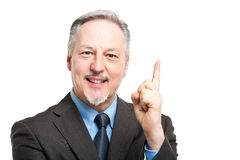Senior businessman pointing his finger up Royalty Free Stock Photography