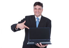 Senior businessman pointing at laptop Royalty Free Stock Images