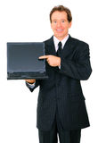 Senior Businessman Presenting Laptop To Viewer Royalty Free Stock Photo