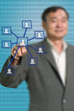 Senior businessman push the social network icon Stock Photos