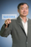 Senior businessman pushed the success button Stock Images