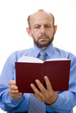 Senior businessman reading a book. Businessman reading a book, focused on the book Royalty Free Stock Photos