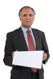Senior businessman reading calendar Stock Image