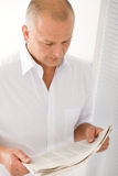 Senior businessman serious read newspaper portrait Royalty Free Stock Photo