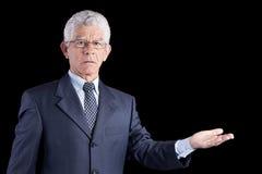 Senior businessman showing something Stock Image
