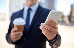 Senior businessman with smartphone and coffee Royalty Free Stock Images