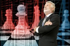 Senior Businessman Smiling over Background of Chess Pieces on Ch