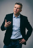 Senior Businessman Speaking and Gesturing Royalty Free Stock Photography