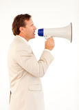 Senior businessman speaking through a megaphone. Handsome senior businessman manager speaking through a megaphone Royalty Free Stock Photography