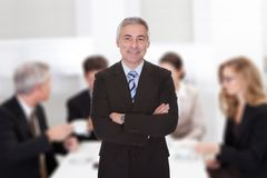 Senior businessman standing arms crossed Stock Photography