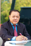 Senior businessman in suit writing proposal. Portrait Stock Images