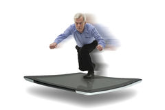 Senior businessman surfing on a PC tablet Stock Photos