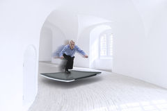 Senior businessman surfing on a tablet Stock Photo
