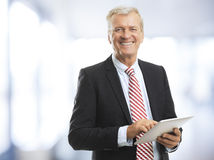 Senior businessman with tablet Royalty Free Stock Photo