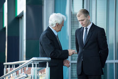 Senior businessman talking with his employee Royalty Free Stock Image