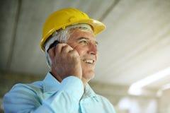 Senior architect using smart phone. Senior businessman talking on mobile phone Stock Photography
