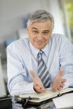 Senior businessman talking to client Stock Photo