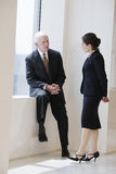 Senior businessman talking with woman colleague. Stock Image