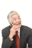 Senior businessman talks with classic cellphone Stock Photography