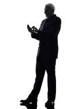 Senior businessman text messaging silhouette Royalty Free Stock Image