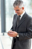 Senior businessman texting Royalty Free Stock Image