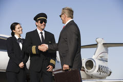 Senior Businessman Thanking Airplane Captain Royalty Free Stock Photography