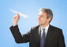 Senior businessman throwing a paper plane Royalty Free Stock Photo