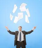 Senior businessman throwing sheets of paper Stock Photography