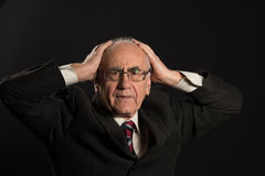 Senior businessman in trouble Royalty Free Stock Image