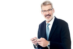 Senior businessman using a cell phone Stock Image