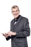 Senior businessman using a cell phone Royalty Free Stock Images