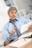 Senior businessman using tablet Stock Images
