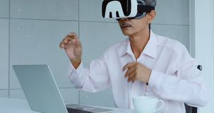 Businessman viewing the contents of VR device.