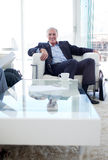 Senior businessman in a waiting relaxing Stock Images