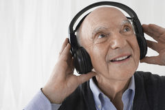 Senior Businessman Wearing Headphones Stock Photos
