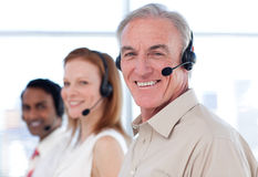 Senior businessman working in a call center Royalty Free Stock Image