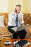 Senior Businessman Working with Computer and Smartphone Stock Images