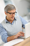 Senior businessman working on laptop Stock Images