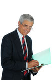 Senior Businessman writing in file Stock Photography