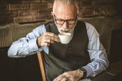 Senior businessmen at cafe. stock images
