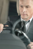 Senior businessmen driving a car. Confident senior businessman d Royalty Free Stock Photography