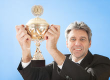 Senior businessmen holding a trophy Royalty Free Stock Images