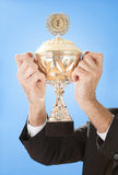 Senior businessmen holding a trophy Stock Photo