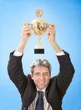 Senior businessmen holding a trophy Royalty Free Stock Photo