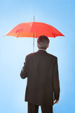 Senior businessmen holding a umbrella Stock Photo